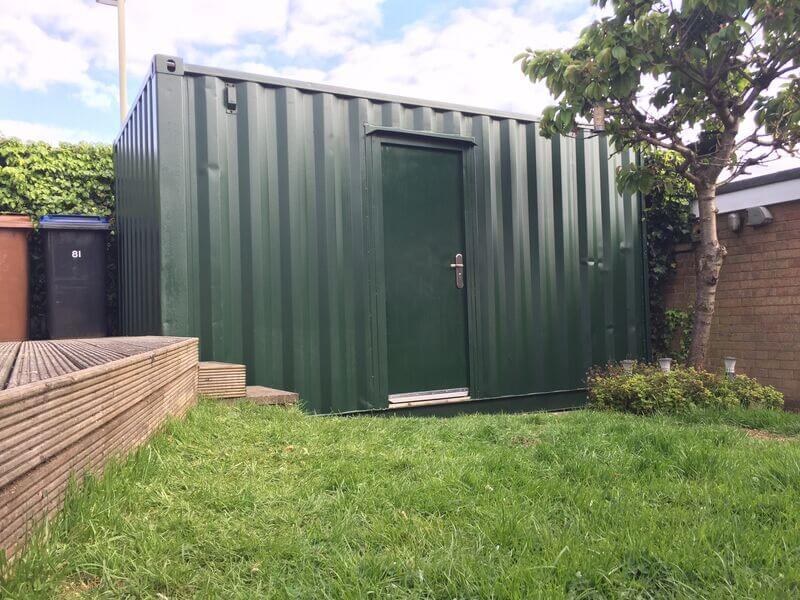 Green Shipping Container in Backyard